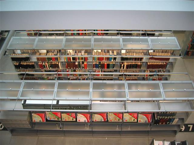 Library Bookstacks with Bartco Lighting on Cantilever Shelving Seattle, WA Book Storage Book Shelving Library Stacks Public Library Shelving Static Shelving Cantilever Library Shelving Education Library Display Shelves Library Shelving Acrylic End Panels Custom Lighting LEED Sustainable Storage Alternative Materials Seattle Public Library Repurposing