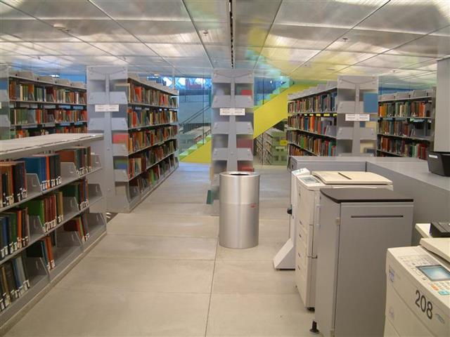 Library Stacks with Acrylic End Panels on Static Cantilever Shelving Seattle, WA Book Storage Book Shelving Library Stacks Public Library Shelving Static Shelving Cantilever Library Shelving Education Library Book Shelves Library Display Shelves Acrylic End Panels LEED Sustainable Storage Solutions LEED Project Alternative Materials Seattle Public Library Book Spiral