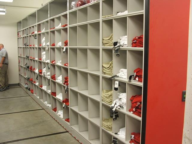 Mobile Shelving at University of Nebraska Mobile Shelving Mobile Storage Shelving Education Athletic Storage Football Equipment Storage Nebraska Collegiate Inventory Uniforms Cubbies Football