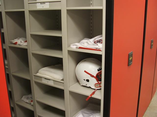Helmet Storage on Eclipse Powered Mobile Storage at University of Nebraska Mobile Shelving High Density Storage System Mobile Storage System Education Football Equipment Storage Athletic Storage Helmets Football Collegiate Cubbies Uniforms University Of Nebraska