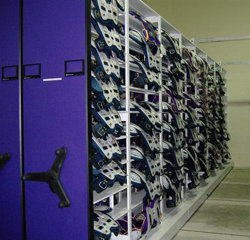 Shoulder pad storage on Mechanical-Assist system at LSU Mobile Shelving Mobile Storage System Education Football Equipment Storage Athletic Equipment Storage Shoulder Pads Football Pads Overhang Shelving Uniforms Louisiana State University Collegiate LSU