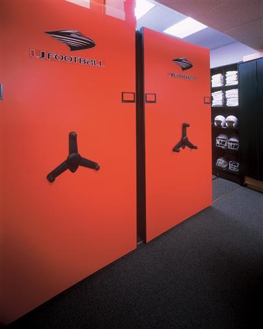 University of Miami - Mechanical Assist Mobile Storage Education Athletic Equipment Storage Athletic Storage Football Equipment Storage Mobile Shelving Mobile Shelving Units Mobile Storage Systems University Of Miami Collegiate Helmet Uniforms