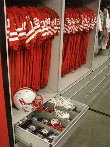 Football Equipment Storag at University of Nebraska Lincoln, NE Hanging Jersey Storage Athletic Gear Storage Mobile Shelving High Density Mobile Mobile Storage Rack Education Athletic Equipment Storage Athletic Storage Football Equipment Storage University Of Nebraska Drawers Divider