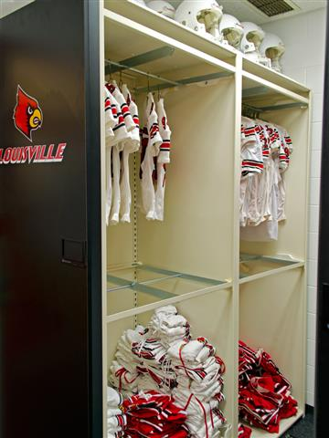 Hanging Uniform Storage at the University of Louisville Spacesaver Mobile Shelving Mobile Storage System Hanging Rods Education Athletic Storage Football Equipment Storage Uniform Storage Jersey Storage Louisville, KY