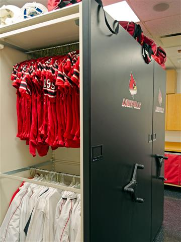 Uniform Storage on Mobile Shelving at University of Lousiville Spacesaver Mobile Shelving Mechanical Assist Mobile High Density Storage Education Athletic Storage Football Equipment Storage Hanging Rods Uniform Storage Jersey Storage Football Jersey Storage Louisville, KY