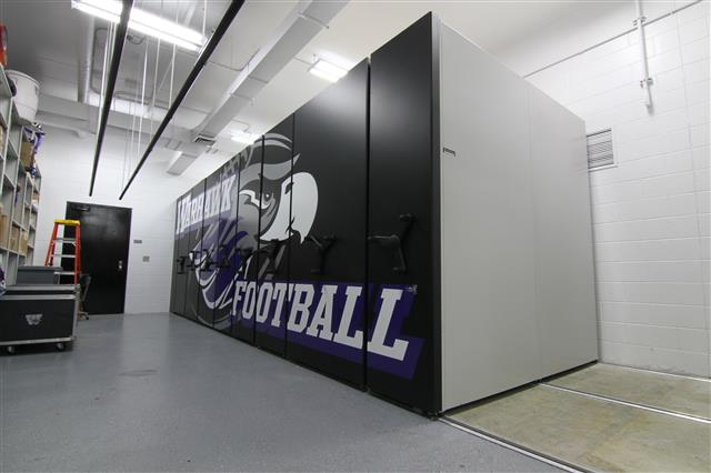Athletic Equipment in High Density Mobile Mobile Shelving Mobile Shelving System Compact Shelving Education Athletic Equipment Storage Football Equipment Storage University Of Wisconsin Whitewater Whitewater, WI UW Whitewater Warhawks
