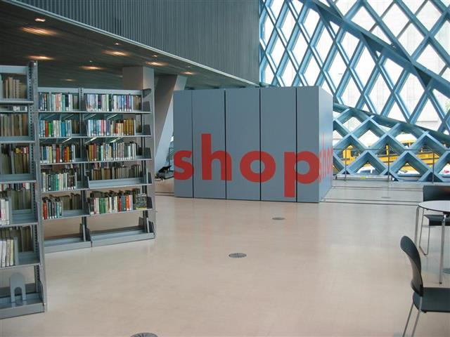 Gift Shop at the Seattle Public Library Created with Mobile Shelving Seattle, WA Gift Shop Gift Shop Storage Merchandise Storage Book Storage Book Shelving Mobile Shelving Moveable Shelving Rolling Shelving Education Library Shelving Library Storage Designer End Panels Alternative Materials Sustainable Storage LEED Repurposing