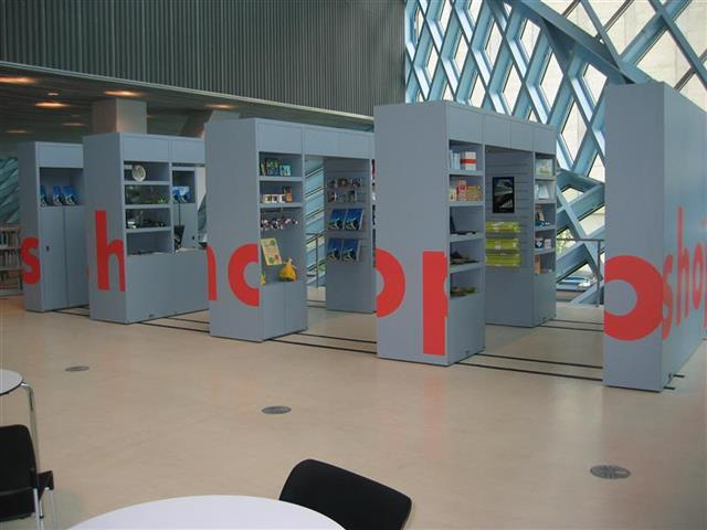 Gift Shop at the Seattle Public Library Created with Mobile Shelving Seattle, WA Gift Shop Gift Shop Storage Merchandise Storage Book Storage Book Shelving Display Shelves Mobile Shelving High Density Mobile Shelving Moveable Shelving Education Library Shelving Library Storage Systems Sustainable Storage LEED Repurposing