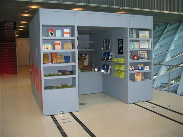 Gift Shop at the Seattle Public Library Created with Mobile Shelving Seattle, WA Gift Shop Gift Shop Storage Merchandise Storage Book Storage Book Shelving Display Shelves Mobile Shelving High Density Storage Rolling Shelving Education Library Display Shelves Sustainable Storage LEED Project Repurposing
