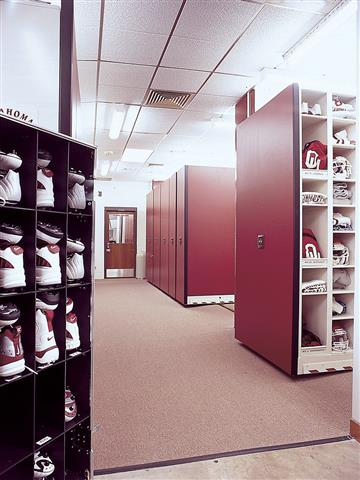 4-Post Shelving at University of Oklahoma Mobile Shelving Mobile Storage Education Athletic Equipment Storage Athletic Storage Football Equipment Storage Collegiate Uniforms Helmets Equipment Storage