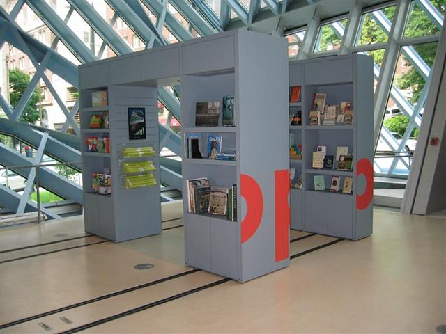 Gift Shop at the Seattle Public Library Created with Mobile Shelving Seattle, WA Gift Shop Gift Shop Storage Merchandise Storage Book Storage Book Shelving Display Shelves Mobile Shelving Mobile Storage Rolling Racks Education Library Shelving Library Storage System Repurposing