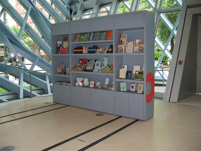 Open Gift Shop at the Seattle Public Library Created with Mobile Shelving Seattle, WA Gift Shop Gift Shop Storage Merchandise Storage Book Storage Book Shelving Display Shelves Mobile Shelving High Density Mobile Rolling Rack Education Library Compact Shelving Seattle Public Library Repurposing