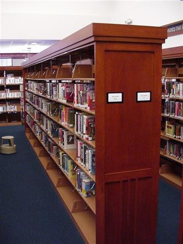 Elegant and Sophisticated Library Book Stack Solution Seward, NE Book Storage Book Shelving Wood-faced Cabinets Static Shelving Cantilever Library Shelving Education Library Shelving Library Storage System Designer End Panels Alternative Materials