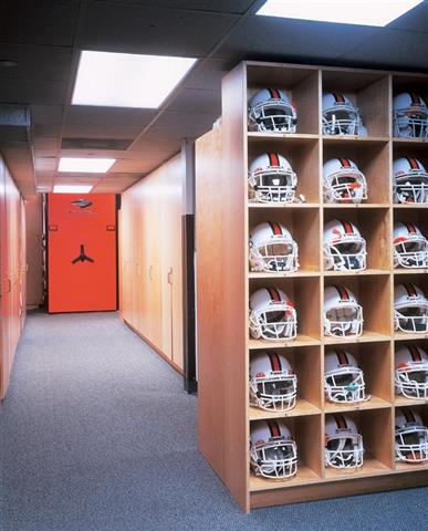 Helmet Storage at University of Miami Storage Cabinets Box Shelving Storage Shelving Education Athletic Equipment Storage Athletic Storage Football Equipment Storage University Of Miami Wood Shelving Mobile Storage System Helmet Storage